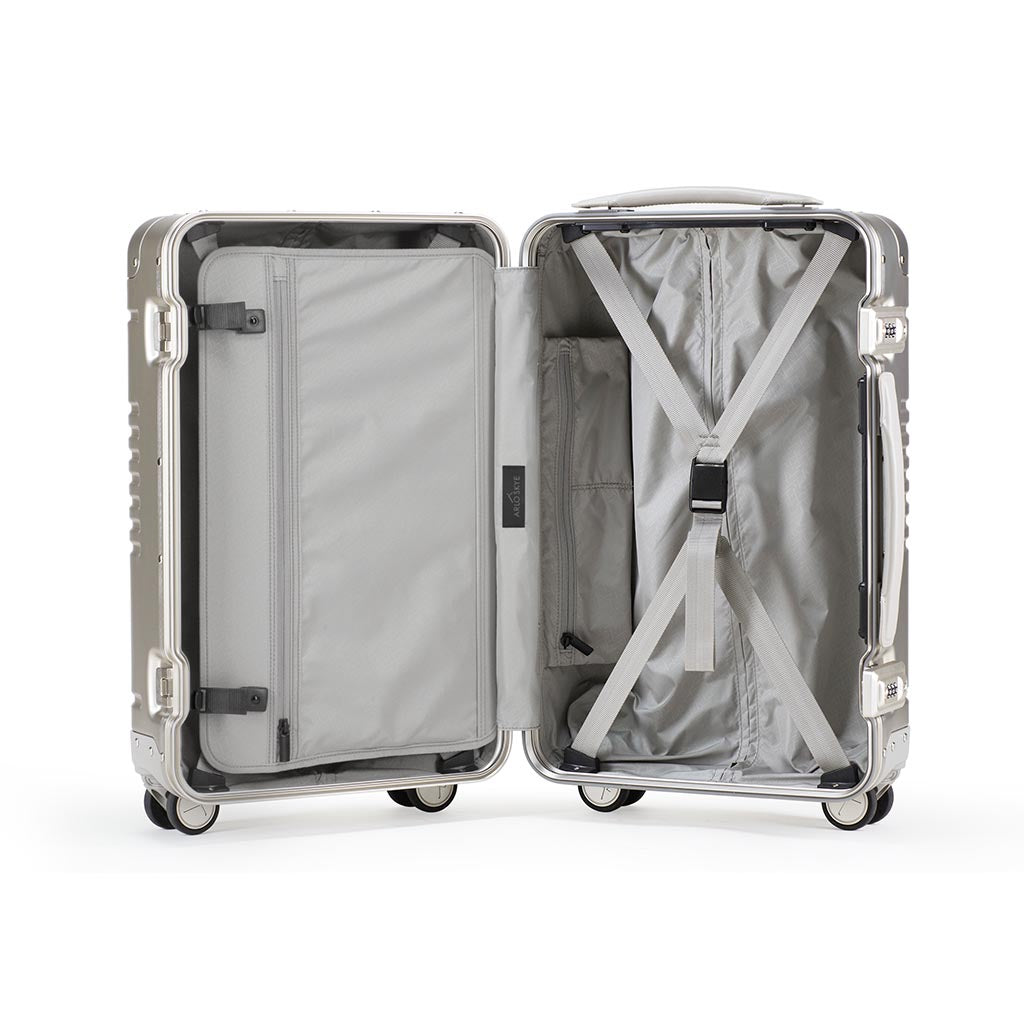 Open frame carry-on in champagne aluminum edition showing the interior of both sides