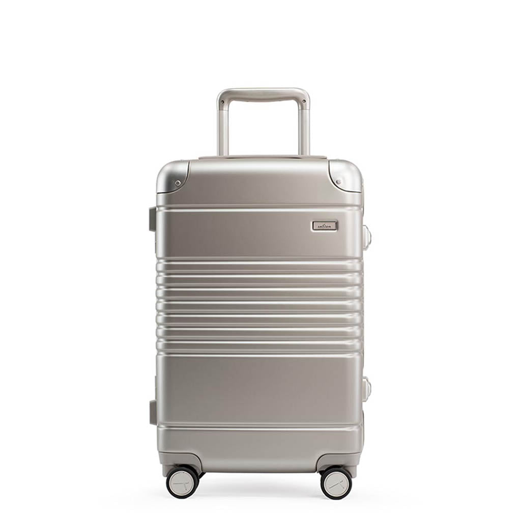 Front view of the frame carry-on in champagne