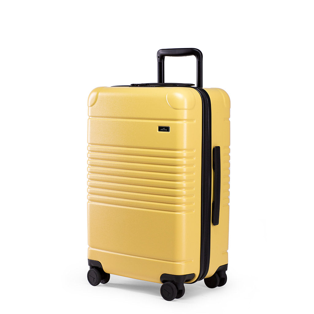 Left facing view of the zipper carry-on max in yellow