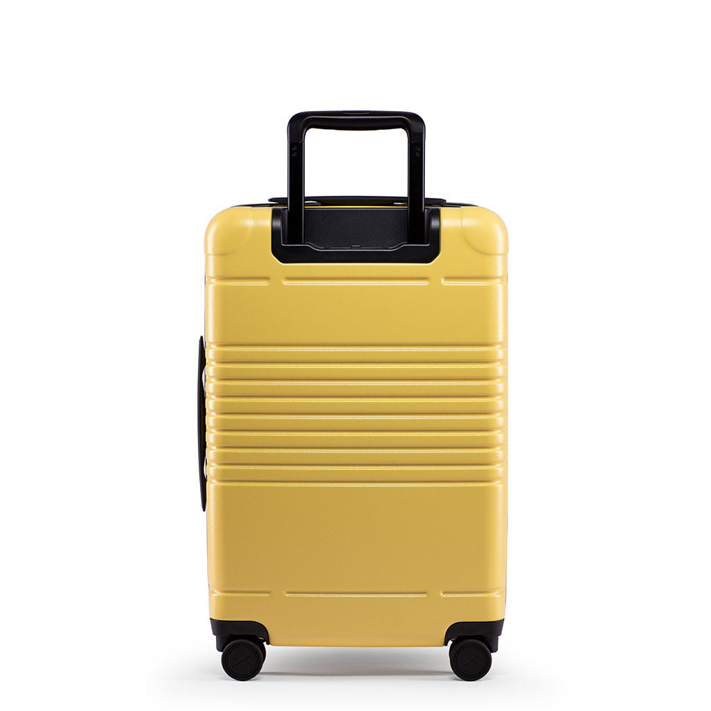 Back view of the zipper carry-on max  in yellow