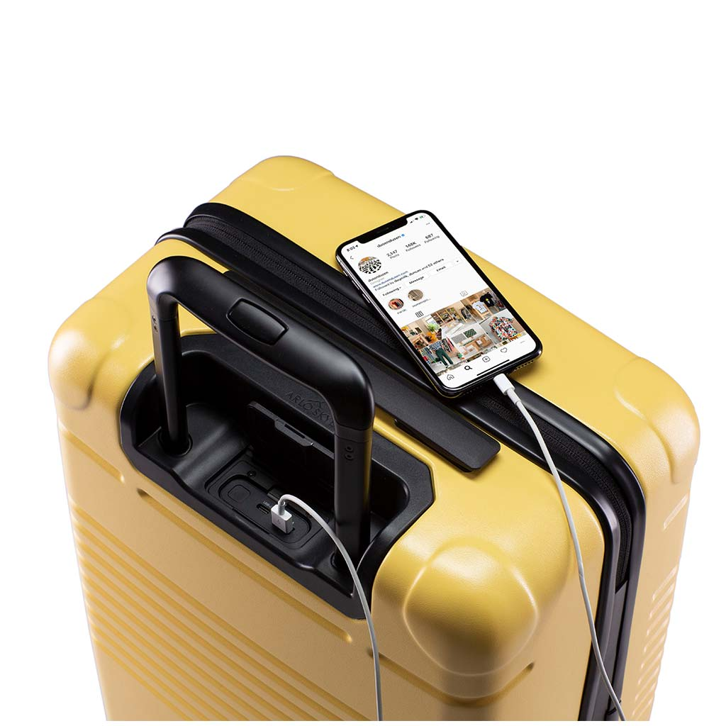 Top view of the zipper carry-on max in yellow with spare charger in use