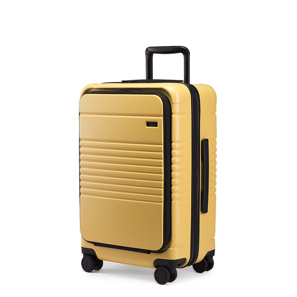Left facing view of the zipper carry-on max with front pocket in yellow