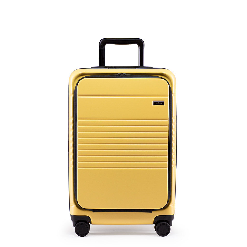 Front view of the zipper carry-on max with front pocket in yellow