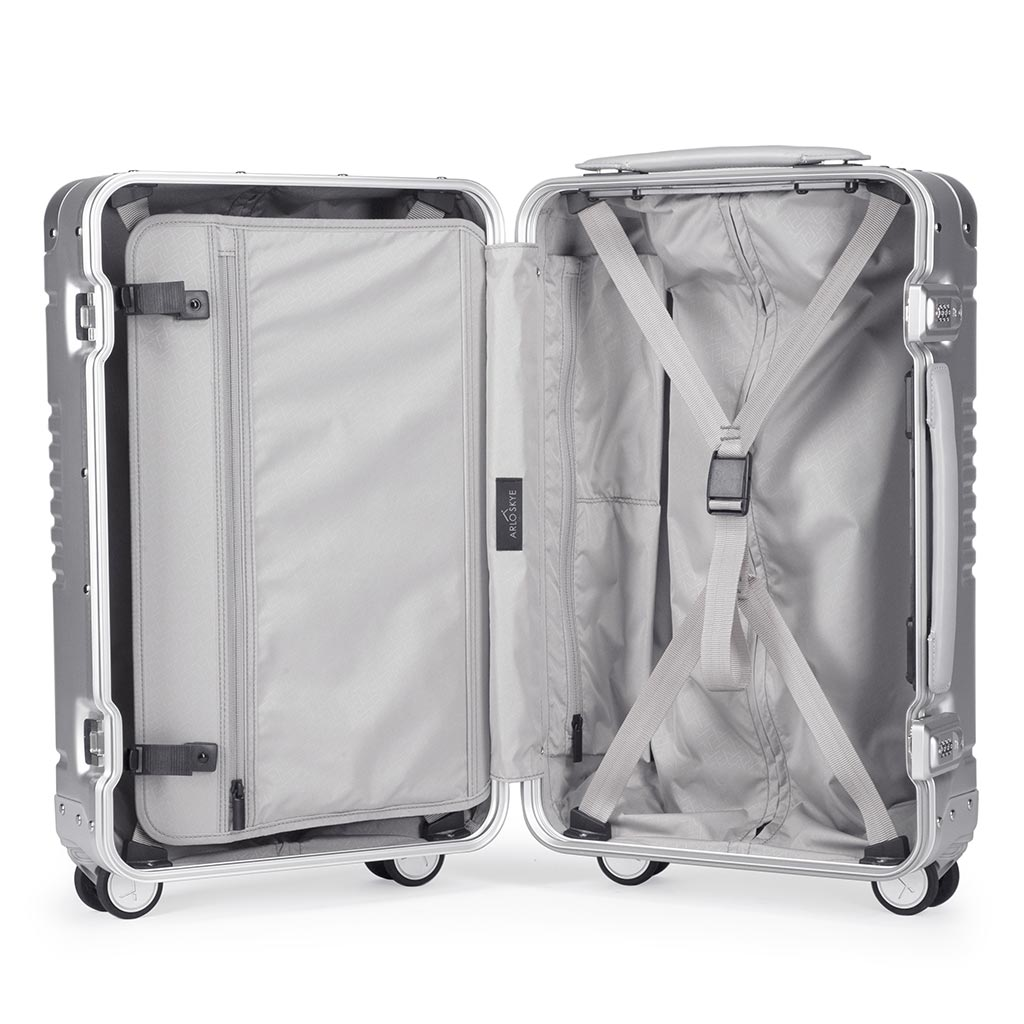 Open frame carry-on in silver aluminum edition showing the interior of both sides