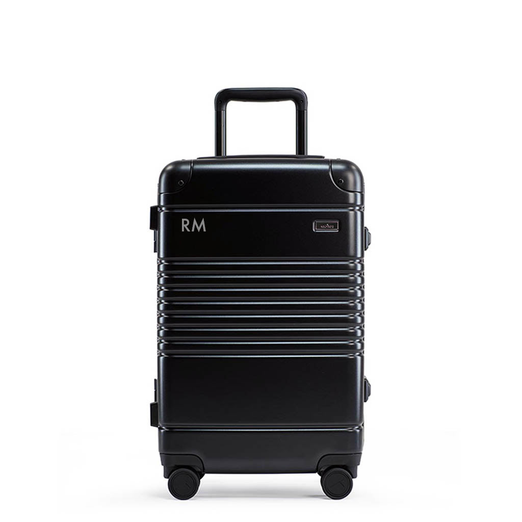 Front view of frame carry-on in black previewing laser engraved initials