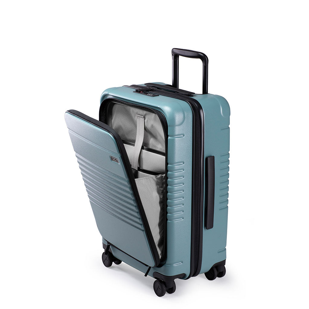 Left facing view of the zipper carry-on max with front pocket in sea sage