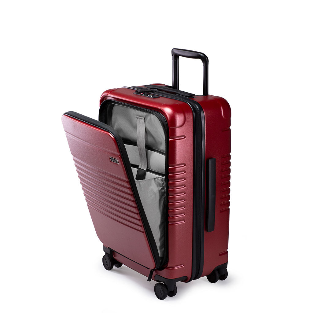 Left facing view of the zipper carry-on max with front pocket in garnet