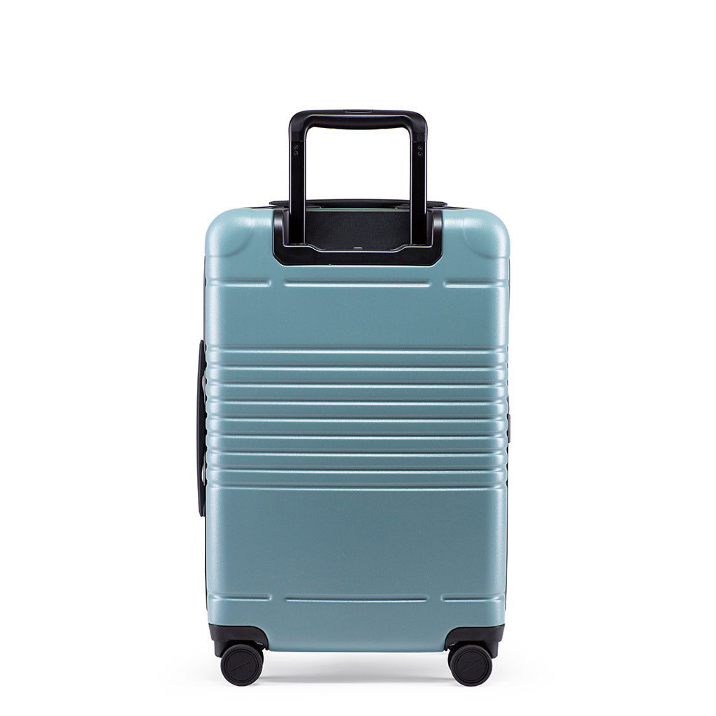 Back view of the zipper carry-on max  in sea sage