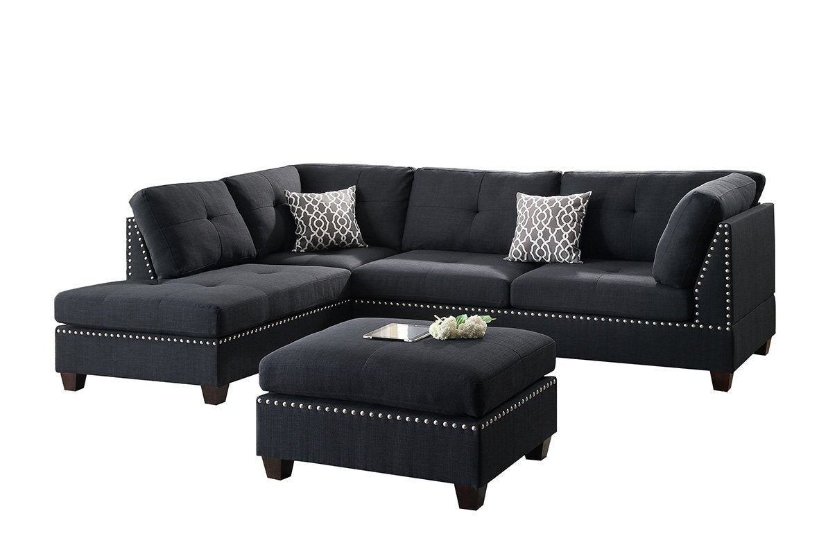 Picture of: Black Reversible Sectional Trimmed With Nickel Finished Nailhead And O Wayne S Home