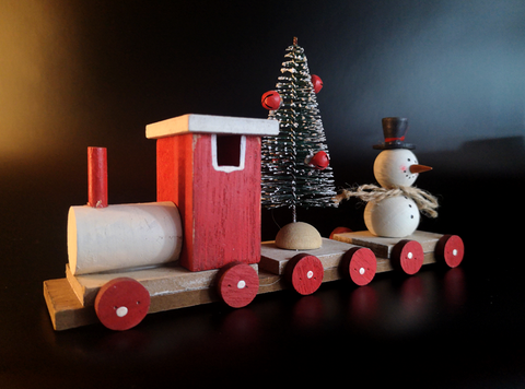 Red wooden Snowman train