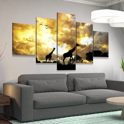 Giraffes Under Cloudy Skies - Amazing Canvas Prints