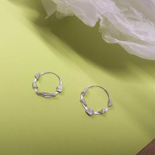 Scrap Hoops made using silver offcuts by Laura Nelson - recycled jewellery