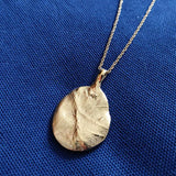 Gold Pendant created using a baby palm print the T.I.Y KIT cast in recycled silver and gold plated