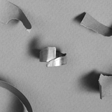 Torn Band by Laura Nelson - contemporary silver jewellery exploring processes. Designed and made in the UK.