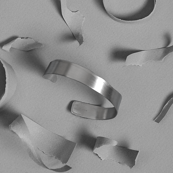 Torn Bangle by Laura Nelson - contemporary silver jewellery exploring processes. Designed and made in the UK.