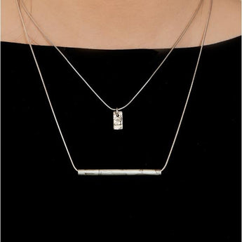 Carse Tube Necklace by Laura Nelson - A simple and minimal sterling silver necklace