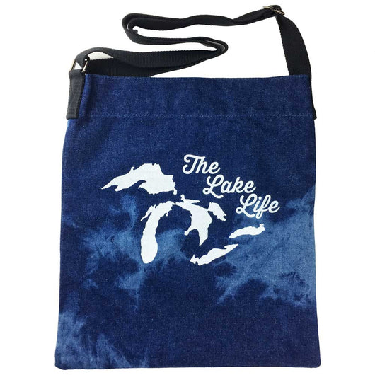 A stylish denim tote with Michigan The Lake Life printed in white on a tie dye tote bag