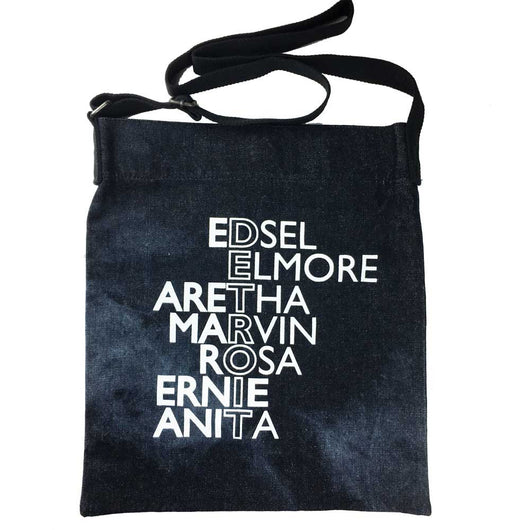 A stylish denim tote with Detroit icons printed in white on a tie dye tote bag