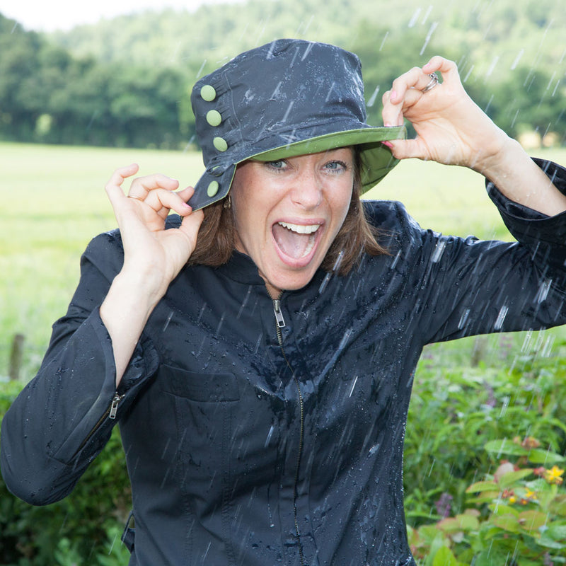 Olney Headwear Olivia Charcoal And Apple Green Wax Ladies Rain Hat On Woman Laughing In The Rain