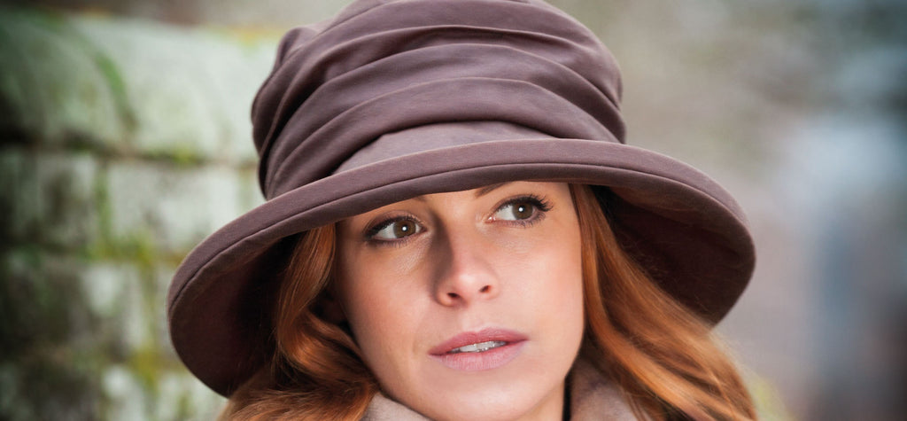 Olney Headwear Annabel brown waxed rain hat on woman