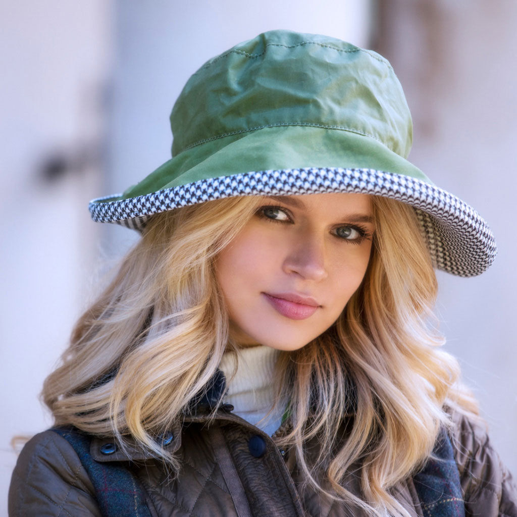 Bradleys Tannery Kate Rain Hat Green With Black And White Dog Tooth Inner Brim On Woman
