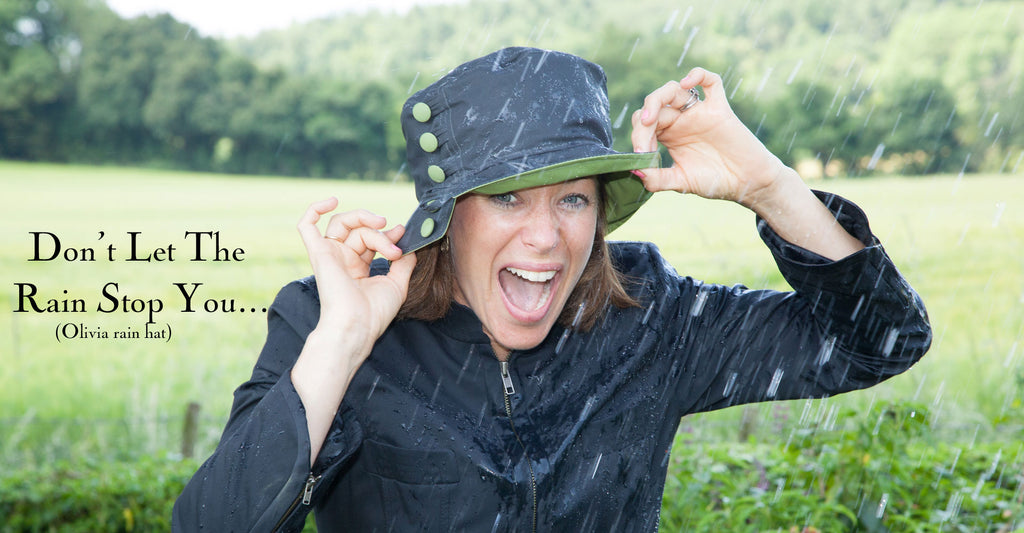 Olney Headwear Olivia Rain Hat in Charcoal and Apple Green on Woman Laughing in the Rain