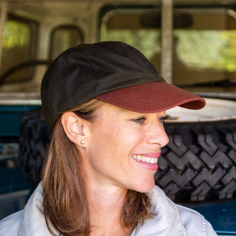 Olney Wax Sports Cap Olive With Brown Peak on Woman Sitting on Car