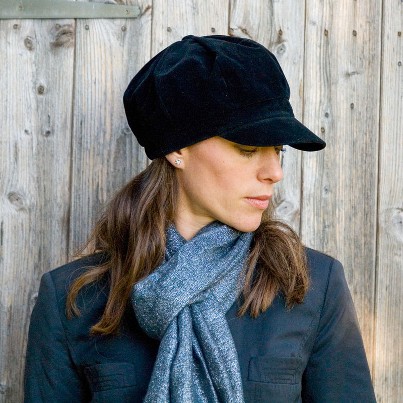 Black velour waterproof Baker Boy hat on woman