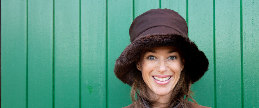 Olney headwear beth brown waxed rain hat with brown faux fur trim on woman