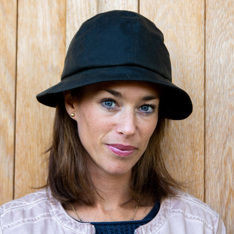 ladies black waxed cloche rain hat on lady