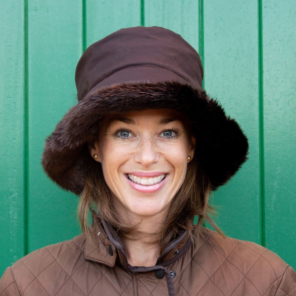 Olney Beth Brown Wax & Faux Fur Trim Rain Hat On Woman