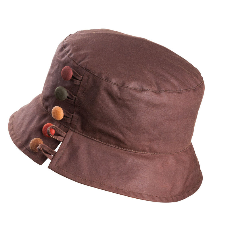 ladies brown waxed bucket style hat with brown great and tan buttons to one side with split brim