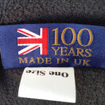 fleece lining of inside of rain hat with label saying 100 years made in UK