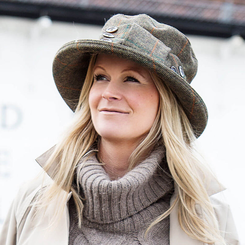 womans tweed waterproof hat with matching tweed bow and buttons on woman wearing a raincoat