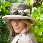 ladies olive green hat with cream bow and under brim