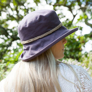 proppa toppa pt72 kathey aubergine linen sun hat with string plait decoration around crown on hat view from back of woman