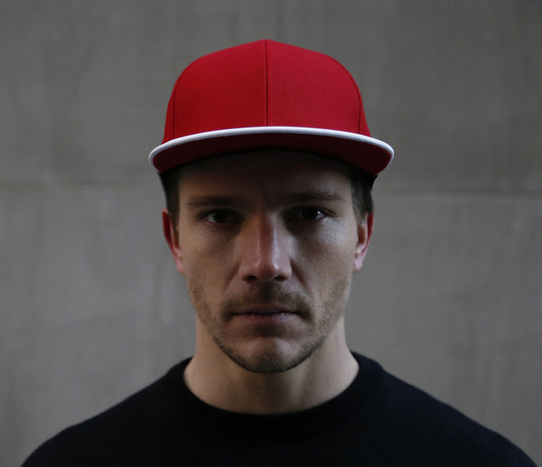 guy wearing a six panel Papa Originals baseball cap with red cotton canvas crown and white Italian lambskin leather brim