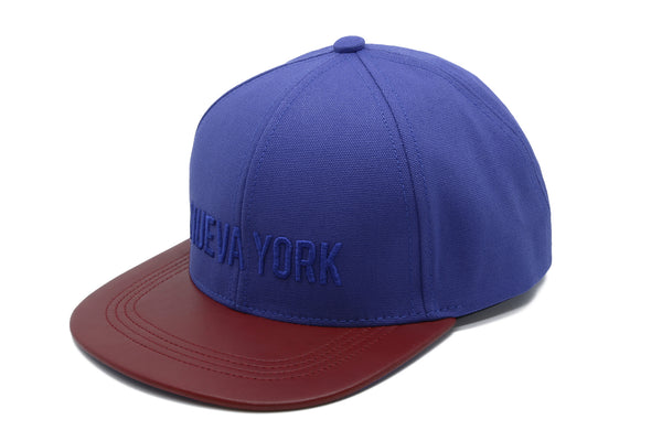 six panel Papa Originals baseball cap with blue cotton canvas crown and red Italian lambskin leather brim and Nueva York embroidery