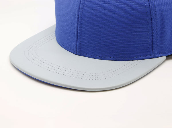 six panel Papa Originals baseball cap with light blue cotton canvas crown and sky blue Italian lambskin leather brim closeup