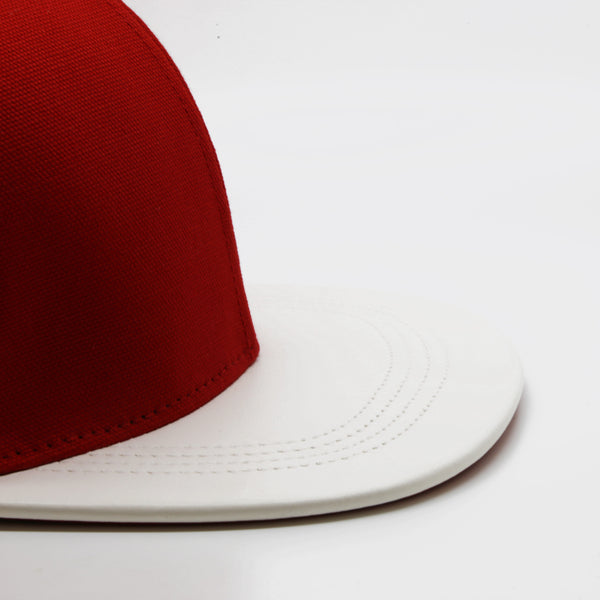 six panel Papa Originals baseball cap with red cotton canvas crown and white Italian lambskin leather brim