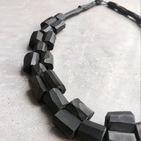 Tubes woven necklace black
