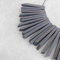 sun necklace gray