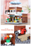 XINGBAO Building Series XB-01105 The Coffee Shop Wedding Store Flower Shop Pet Shop Set 4 in 1 - Your World of Building Blocks