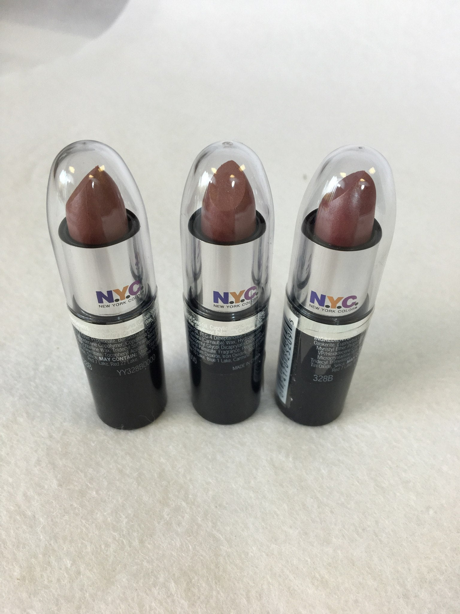 NYC Ultra Moist Lip Wear Lipstick 328B Plum Rum x 12 (£0.50 each) - Fizzy Peach Ltd
