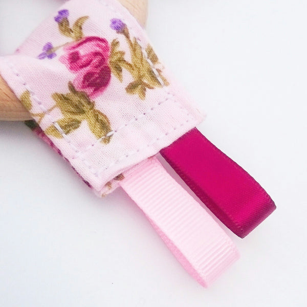 Wooden pink floral and burgundy baby teething toy