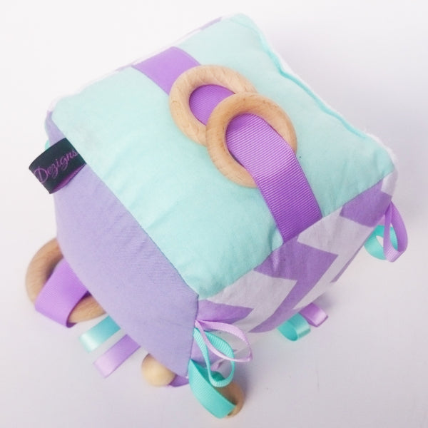 Educational toys for baby in purple and mint colours