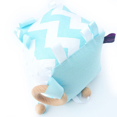 blue zig zag educational toy cube with baby rattle