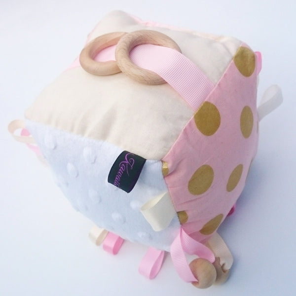 Pink and gold polka dot cognitive cube toy