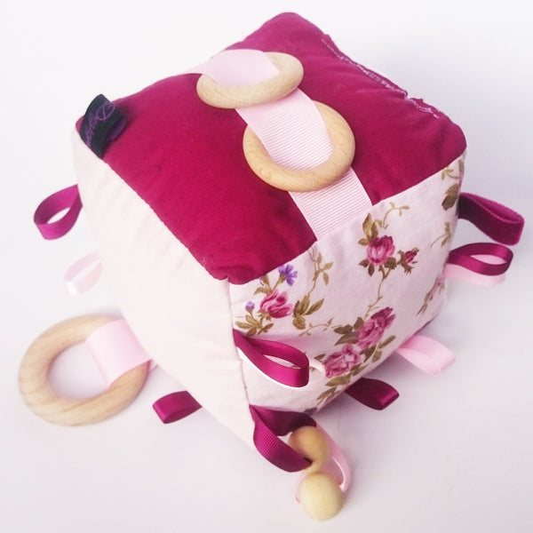 Pink floral and burgundy cognitive activity cube toy