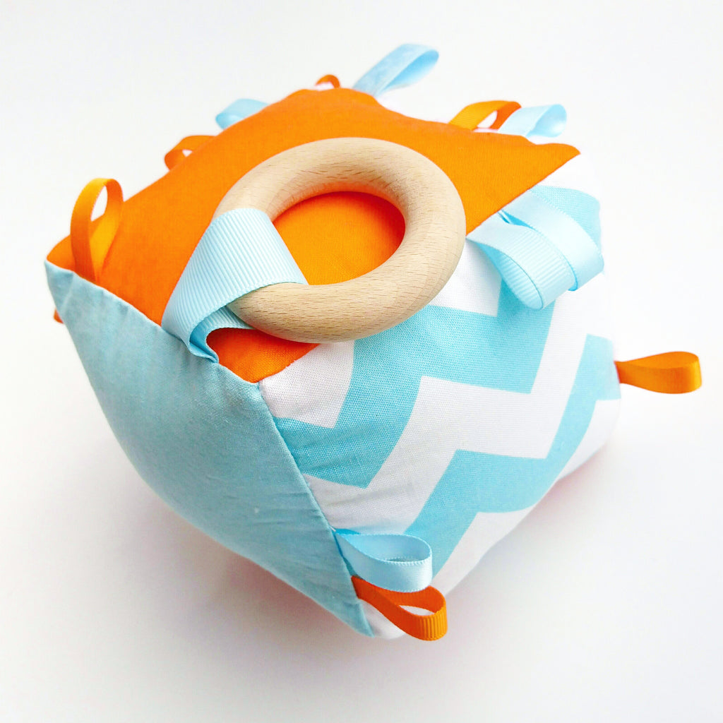 Baby blue and orange chevron cognitive cube toy